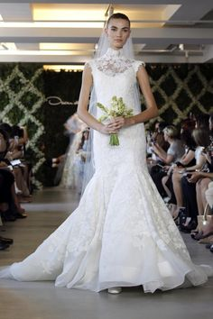Oscar de la Renta 2013 Bridal Collection - a classic silhouette enhanced with delicate lace.
