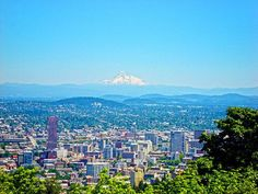 Summer view of snow-capped Mount Hood and downtown Portland, Oregon. #travel #northwest