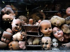 Doll heads everywhere.  Happy Halloween!  I promise all my dolls always kept their heads!  A few maybe got hair cuts.