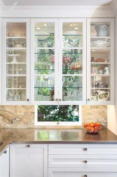 glass cabinets in front of window--Rochelle Silberman