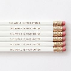 THE WORLD IS YOUR OYSTER    This listing is for 6 unsharpened white grey lead pencils with the text THE WORLD IS YOUR OYSTER text printed in