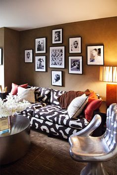 love the warm colors, textures, black and white photos on the wall w/ cool metallics