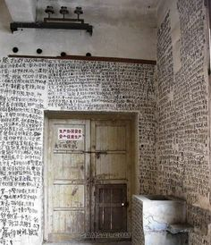 An anonymous author's novel written on the walls of an abandoned house in Chongqing, China.