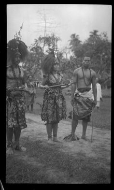 Three individuals with traditional Samoan clothing. Creator/Contributor: Lambert, Sylvester Maxwell, 1882-1947, Photographer Date:between 1919 and 1939 Contributing Institution: UC San Diego, Mandeville Special Collections Library