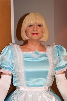 Sissy Hypnosis maid Isla in baby blue satin dress trimmed with white lace.