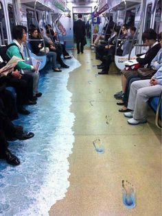 """I think this picture is interesting because it shows the idea of """"ad creep,"""" where advertising is starting to be done in seemingly unconventional places. They have started to incorporate it more in transit and I found it interesting to be in this train. http://www.businessinsider.com/15-weirdly-effective-places-to-advertise-youve-never-thought-of-2011-1?op=1"""