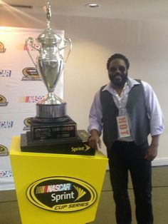 Chad Coleman with the Sprint Cup Oral-B USA 500 trophy