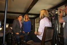 """Shane Meder (left) of Black Sheep Interiors and Paige Ruhl of Lake Oconee's DreamBuilt in front of the camera with """"Home And Style"""" host Don..."""
