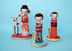 Regal geishas woo while surrounded by Scuba Blue. These Kokeshi Dolls were crafted by Hine Mizushima.