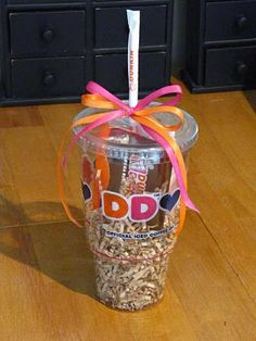 Cute gift Idea: Great way of giving people a Dunkin Doughnuts gift card! Ask for any cup and lid then get a straw fill the cup with some tissue (or the brown fake scrunch grass whichever you like best) then tie some cute ribbon on the straw