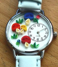 Watch with tiny little mushrooms made by quilling technique