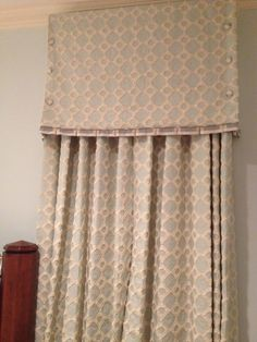 interesting valance, pleated flange, buttons on sides