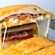 Liv Life: Becky's Famous Football Party Stromboli...frozen bread dough, ham, salami, pepperoni, italian herbs, provolone, mozz, SO EASY..and u will be a superstar in the kitchen...sprinkling a little cornmeal on baking sheet gives  crusty deeelish bottom to this cheesy melty dinner/party dish. I'm all in for this!
