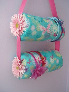 Thank You to Melissa Grilliot for our Pin of the Day! Children's Headband Holder- Try and make using oatmeal containers covered in paper or fabric with ribbons to hold them together!
