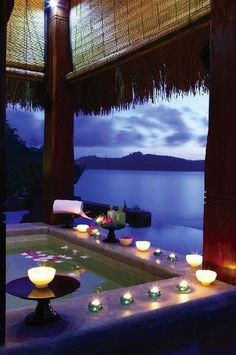 Romantic spa overlooking tropical paradise at night