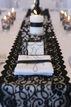 """Timeless and elegant.. The black lace runner with the continuing theme of lace wrapped around a votive candle for a stunning """"Black Tie Affair"""" theme."""