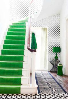 Green staircase runner and polka dot wallpaper