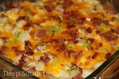 Cheesy Loaded Twice-Baked Potato Casserole, made with potatoes that are baked twice, and including all my favorite loaded baked potato ingredients - bacon, butter, sour cream, cheddar cheese and green onion - all in a simple casserole form.