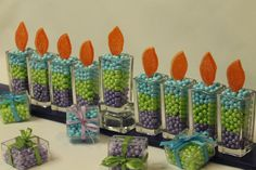 Hanukkah Candy Menorah made with Candy Pearls and Orange Slices. Via Esther O Designs