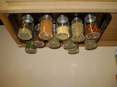 Why didnt I think of this?? A magnetic spice rack. A cookie sheet screwed to the under side of the cupbaord. Then magents hot glued to the lid of baby food jars. So smart! This would definitely clear up some cupboard space.