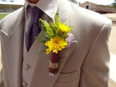 Boutonniere for the groomsmen designed in a spent shotgun shell