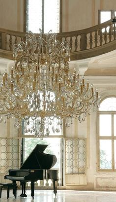 interiorstyledesign: Elegant chandelier and piano