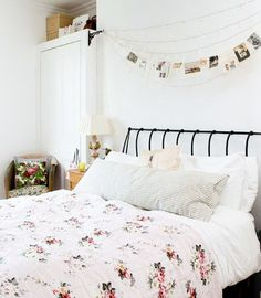 Pictures on string lights above bed