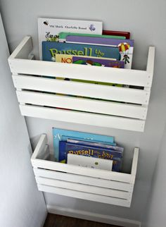 cut a crate (they sell them at hobby lobby) in half and hang them on the wall to store books etc.