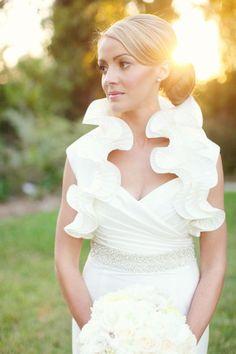 Wedding Gown by Siri. Bolero (designer unknown) from Unbridaled in Austin. love the ruffles!