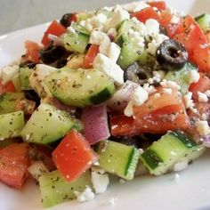 Chunky Greek Salad Recipe--easy lunch (optional add chickpeas or avocado) cumcumbers, tomatoes, onions, and Italian Salad Dressing ( one pack of salad dressing mix made with olive oil, vinegar, and water)