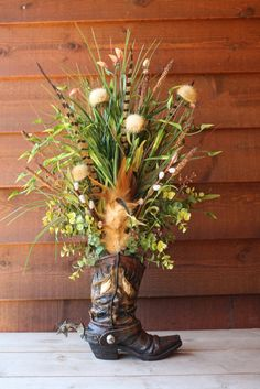 Handmade WESTERN FLORAL flower ARRANGEMENT cowboy boot real pheasant feathers home decor. $59.99, via Etsy.
