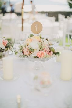 Centerpiece | On SMP: http://www.StyleMePretty.com/2014/03/07/lakeside-wedding-at-castle-maria-loretto/ Photography: Thomas Steibl
