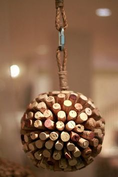 22 ways to repurpose wine corks, including these hanging cork balls as seen in Anthroplogie.