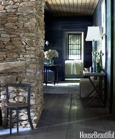 "The local fieldstone found for the walls was originally covered in lichen and moss, ""so gorgeous it inspired all the colors in the house,"" Ferrier says."