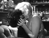 """""""Some Like It Hot"""" (1959)--features a memorable, racy seduction scene  involving champagne and soft music, which occurs on a yacht between luscious and voluptuous band member Sugar Kowalczyk (Marilyn Monroe) and Joe (Tony Curtis), a broke saxophone player who was impersonating a rich oilman"""
