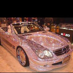 Pink glitter Mercedes!! Can you imagine driving that in the sun lol!
