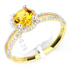 This brilliant citrine diamond gemstone ring has a 0.75ct round cut citrine main stone in a prong setting. There are round cut diamonds in prong settings with a total weight of 0.27cts. The color and clarity are H/I and I1/I2 respectively. $319.00