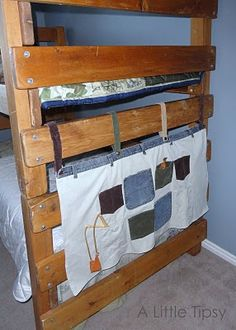 Upcycle old clothes into hanging toy (etc.) storage pockets.
