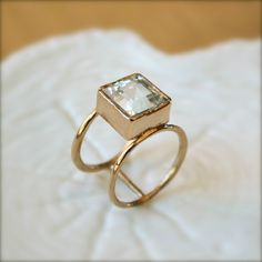 Double Wheel Gold Ring With Square Aquamarine Stone.