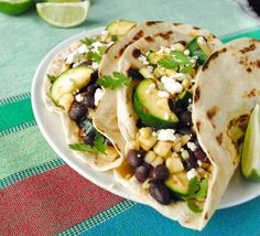Grilled Veggie Tacos...lime, avocado, black beans, grilled corn, cilantro, grilled zucchini,chipotle salsa, grilled onions.