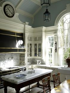 stove hood/surround, clock, ceiling, window