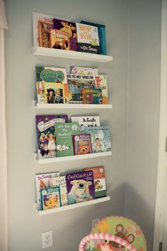 IKEA Ribba picture ledge shelves for bookshelves.  Good idea on a budget.