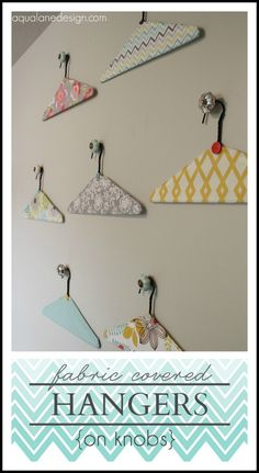 DIY ~ Need something for the walls in your laundry room or craft room? These fabric covered hangers hung on decorative knobs are the perfect solution!