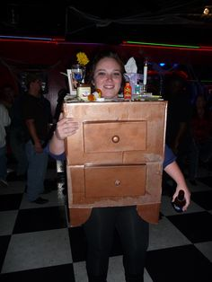 Adult Halloween Costume- *One Night Stand* Won 1st place!   Made with a large cardboard box.   Cut off bottom flaps of box and used them to make *legs*.   Cut out large hole for head; smaller ones for arms.   Hot glued shoe box lids to box for drawers.   Added real drawer pulls.   Spray painted entire box with some left over paint I had.    Hot glue gun-   Cheap doily over hole where head goes then cut an X in it to allow for head.   Added keys, photo frame, small fake plant, condoms, etc. to...