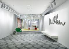 An optical mise-en-scène guides visitors into the Milliken showroom (11-1149) at #NeoCon14. #NeoConography #IDNeoCon