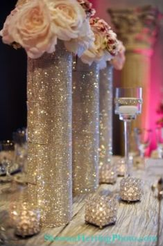 Blinged out centerpieces {via Project Wedding user ChancesAre}