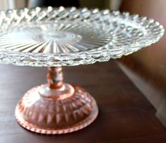 "14"" Pink Cake Stand Pedestal / Glass Cake Stand / Cake Pedestal / Vintage Cake Plate Pedestal / Cupcake Stand Truffle Pedestal. $70.00, via Etsy."