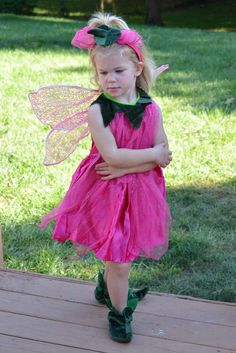 """I mean how cute is this tulip fairy costume? I love the little shoes that come with the tulip fairy costumes making it just adorable. I mean seriously look at the little green slippers and the headband, they just complete the look."""
