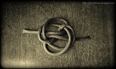 A single strand button knot, #647 in ABoK, loosely tied before tightening