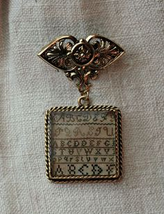Schoolgirl Sampler Brooch-Schoolgirl sampler brooch, antique sampler, brenda gervais, with thy needle & thread, country stitches